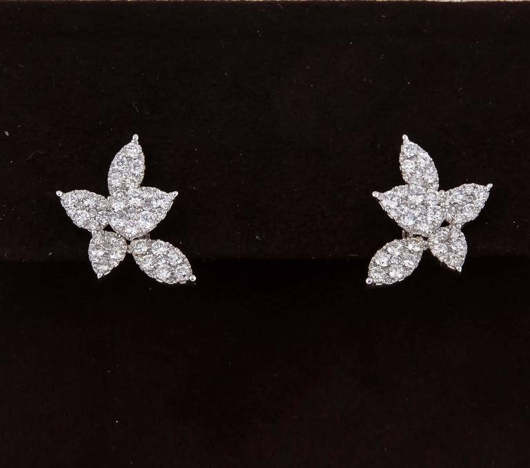 A beautiful pair of diamond earrings.  1.85 cts of F color VS clarity round brilliant cut diamonds set in pear and marquise shapes.   Approximately .78 inches from highest to lowest point and .40 inches wide.   18k white gold