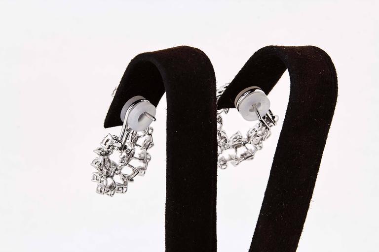 Women's Diamond Scene 3.91 Carat Diamonds Gold Swirl Hoop Earrings For Sale