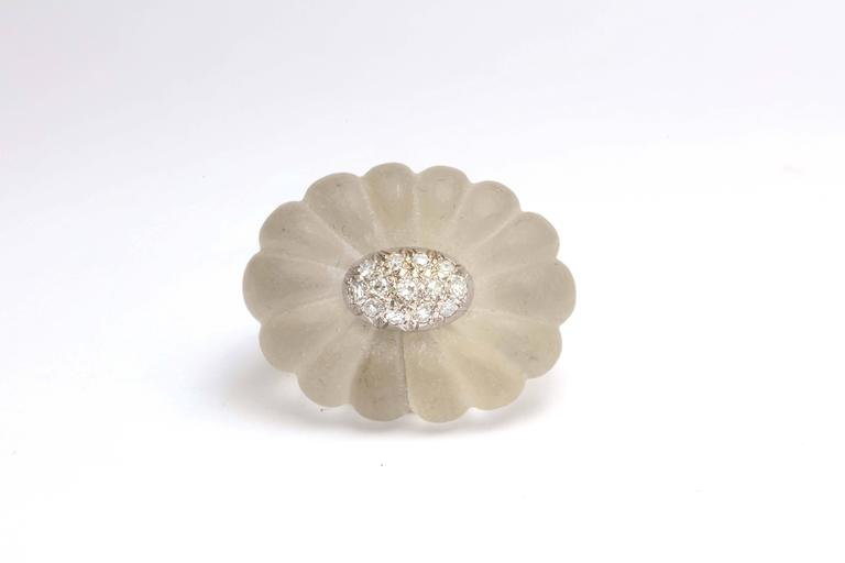 Melon shaped Rock Crystal top with white gold oval pave set with Diamonds. Marked 18kt Italy.  Size 7 but can be sizedShank is in 18kt Yellow Gold and it mirrors the frosted rock crystal Melon shaped top.   Very high style revamp of the 1930's.