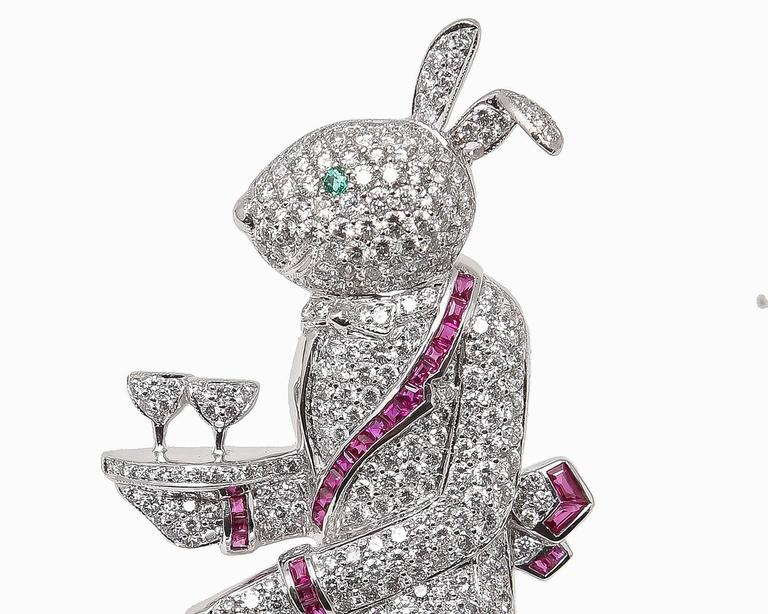 An incredible brooch depicting a rabbit waiter always at your service!  Meticulously crafted in 18 karat white gold embellished with 5.50 carats of brilliant cut diamonds having E color, VS1 clarity.  An impressive 3 carats of beautifully matched