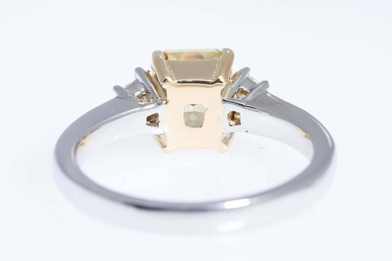 Women's GIA Intense Yellow 1.62 Carat Emerald Cut Diamond Platinum Three-Stone Ring For Sale