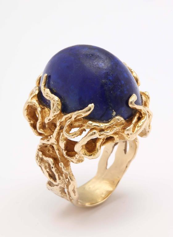 Large 50's 14kt kt Yellow Gold Branch setting, within which sits a large Cabochon Lapis Lazuli Oval stone. This certainly makes a statement.  Can be worn on an index or ring finger defending on how much attention that you want to attract. Fits a