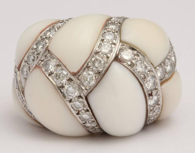 Extremely elegant Bombe Coral Ring beribboned with pave set Diamonds in Platinum.  The top of the Ring contrasts with an 18kt Yellow Gold Shank.  Signed Turi - 18kt