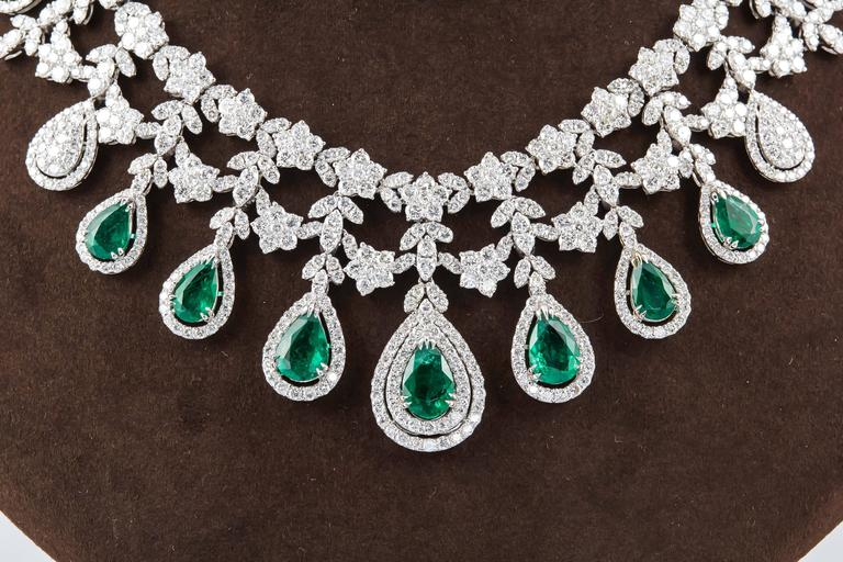 A beautiful emerald and diamond necklace with an very important look.   12.05 carats of fine green emeralds. 28.04 carats of round brilliant cut diamonds.   18k white gold   The design resembles a tiara.   Approximately 16.5 inch length