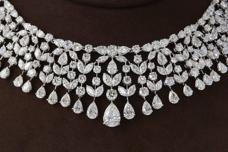 An incredible important diamond necklace in a timeless design.   104.20 of G color VS clarity pear, marquise, and round brilliant cut diamonds + a 3.20 GIA certified pear shape center diamond all set in platinum.  A total of 107.40 cts of