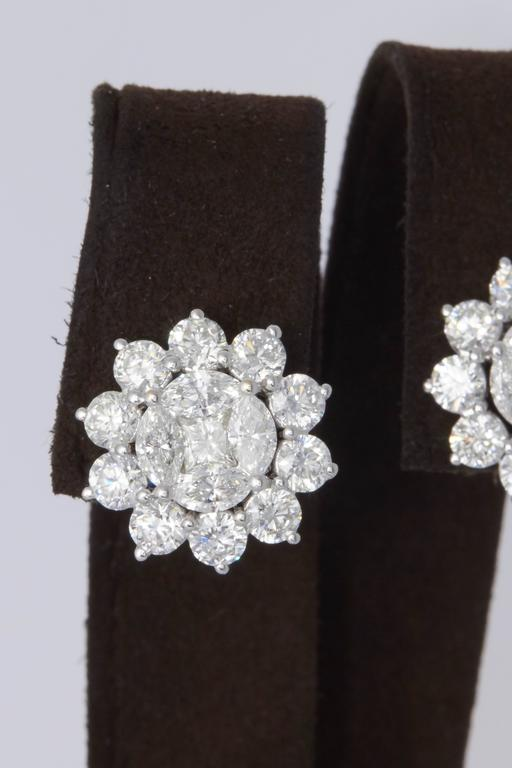 Unique Diamond Illusion Stud Earrings with Halo Design For Sale 1