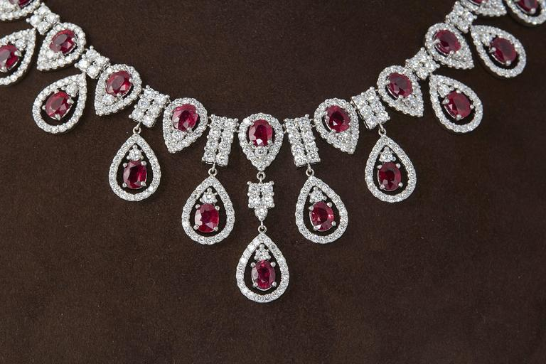 A beautiful piece!  38.61 carats of fine color and clarity oval shaped Ruby  26.32 carats of F/G color VS clarity round brilliant cut diamonds  14k white gold  Approximately 18 inches in length, but can easily be adjusted.