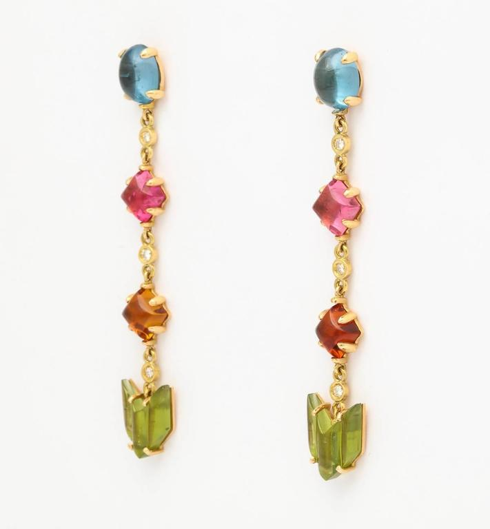 18k yellow gold cabachon semiprecious stone and diamond drop earrings  2 oval cabochon blue topaz 2 square cabochon pink tourmalines 2 square cabochon citrine 2 carved peridots 6 full cut diamonds 0.15 ct.