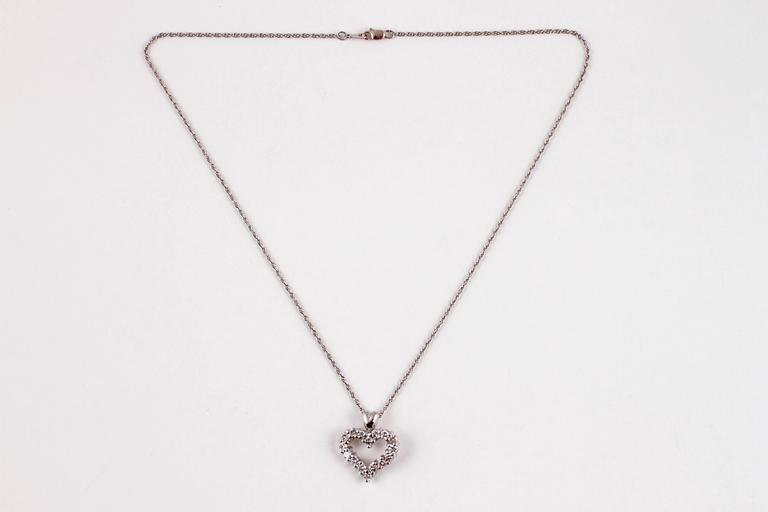 .75 Carat diamond heart pendant in platinum mounting with 16 inch platinum chain.