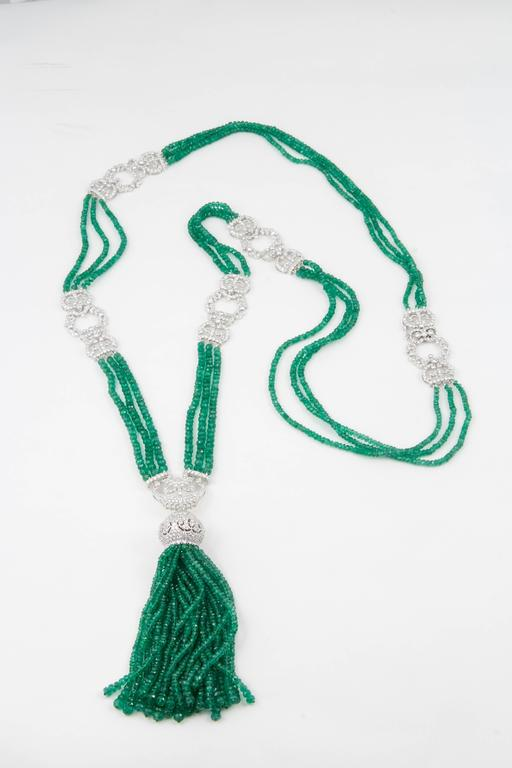 A fabulous and unique piece!  Over 300 carats of fine green emeralds, 16.26 carats of F/G VS diamonds.   This piece can be worn to a black tie affair or more casually.   A beautiful pop of color along with the sparkle from the emeralds and