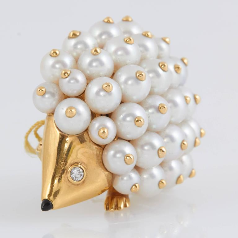 Charming Chanel Porcupine Pin finely crafted in 18K yellow gold with pearl body.
