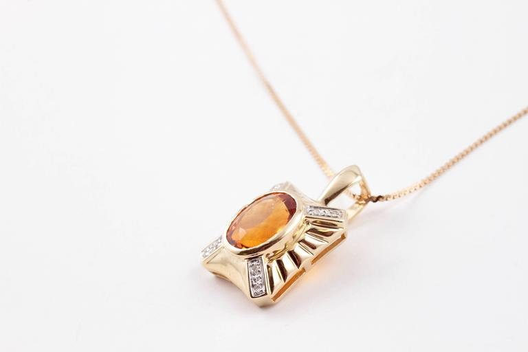 Lovely orange color, 24 inches in length, 14 karat yellow gold beauty!