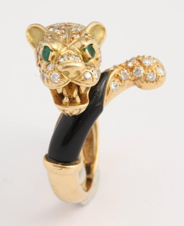 18kt Yellow Gold and black Onyx Lion ring set with a diamond studded Head and Tail.  Eyes are set with vibrant Emeralds.  Can be sized .  Presently a size 8.  Ultra chic and stylish.  Grrrrrrrrrr!