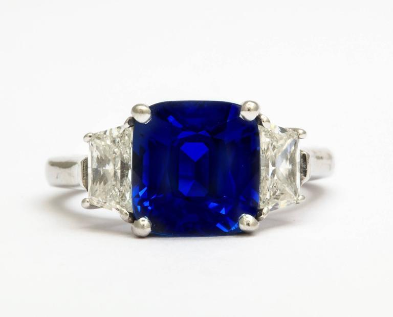 platinum cushion cut sapphire ring 4.33 ct. set with 2 trapezoid shaped diamonds weighing 0.90 ct. total weight  GIA report # 2171402027 - sapphire shows no indications of heating