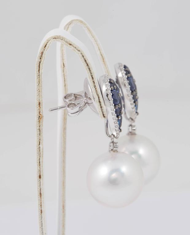 Round Cut South Sea Pearl and Sapphire Cluster Dangle Earrings For Sale