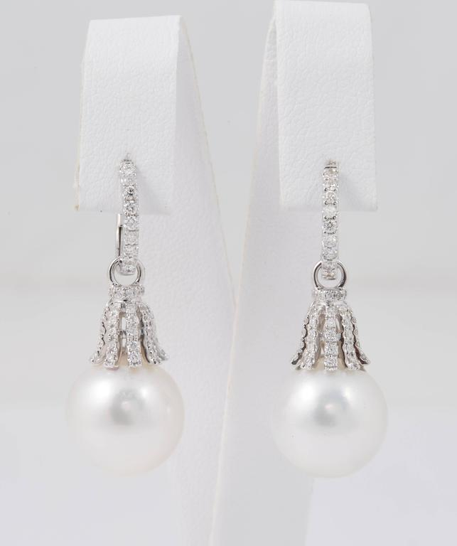 18K white gold Diamonds: 0.60 Cts South Sea Pearls: 13-14 MM