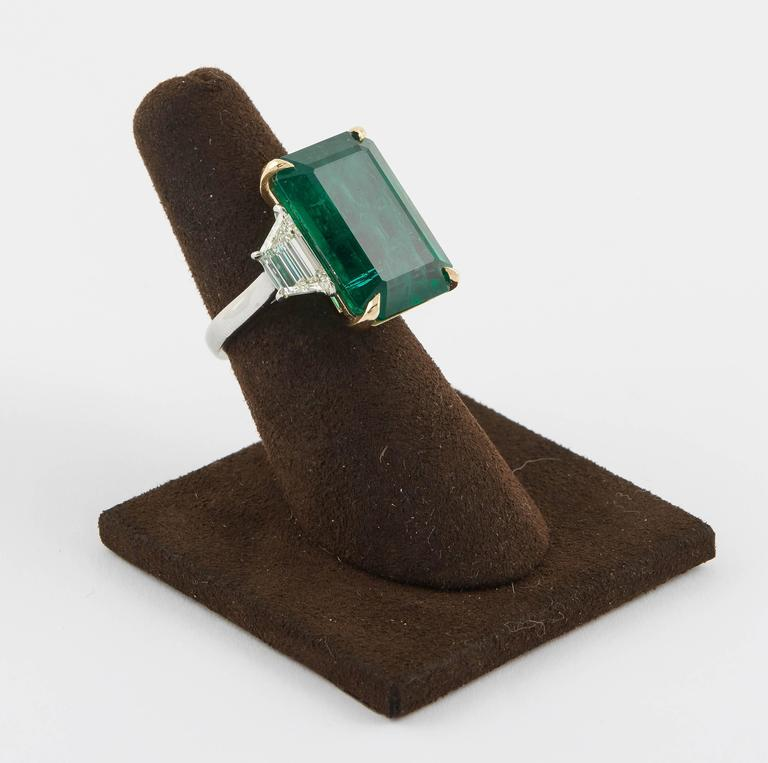 A beautiful emerald.  GIA certified 18.83 carat emerald set along 2.08 carat of side diamonds.   Set in platinum and yellow gold.   Made in New York   Currently a size 5.75 but can easily be resized to any finger size.