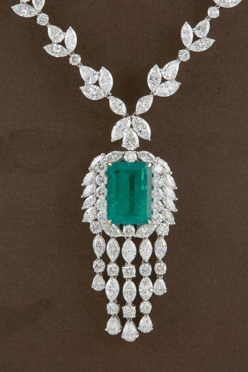 A gorgeous Colombian Green Emerald set in a FABULOUS necklace!  20.98 carat GIA certified Colombian Green Emerald with beautiful color and luster.   68.06 carats of F/G VS round, pear and marquise cut diamonds.  Made in New York and set in