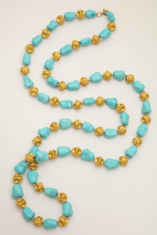 One 18kt Yellow Gold Alternating Turquoise Nugget Pieces With 18kt Yellow Gold Crater Design Ball Pieces To Form A 40 Inches Long Chain Necklace. Note: Necklace May Be Worn Doubled To Form Two 20 inch Necklace Length Chains.Easy To Open And Close