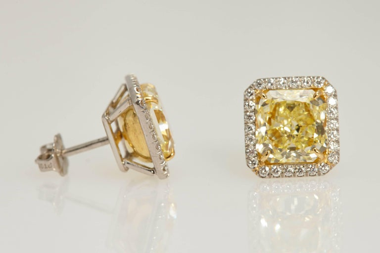 Modern Radiant GIA Fancy Yellow Diamond Earrings 6.61 Carat For Sale