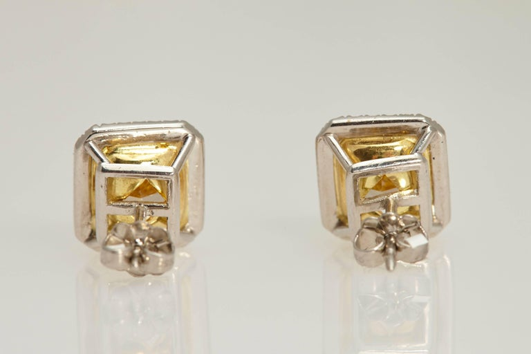 Women's Radiant GIA Fancy Yellow Diamond Earrings 6.61 Carat For Sale