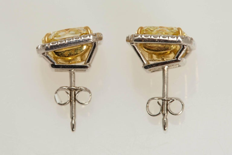 Radiant GIA Fancy Yellow Diamond Earrings 6.61 Carat In Excellent Condition For Sale In New York, NY