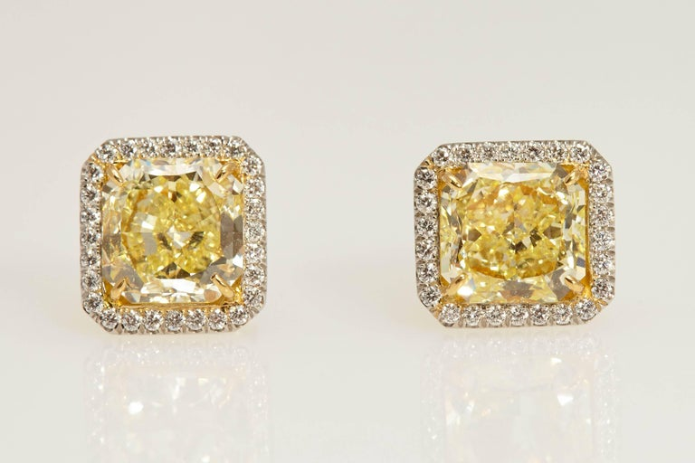 Radiant GIA Fancy Yellow Diamond Earrings 6.61 Carat For Sale 1