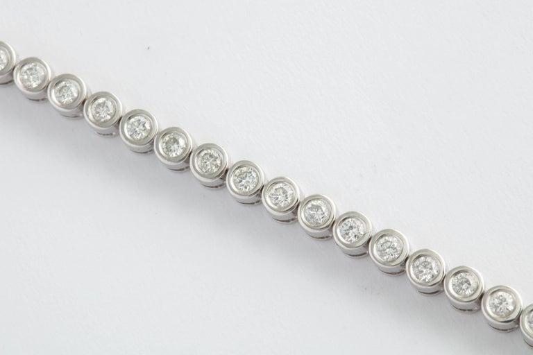 Modern Wempe White Gold and Bezel Set Diamond Tennis Bracelet For Sale