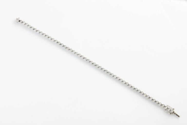 Wempe White Gold and Bezel Set Diamond Tennis Bracelet In Excellent Condition For Sale In New York, NY