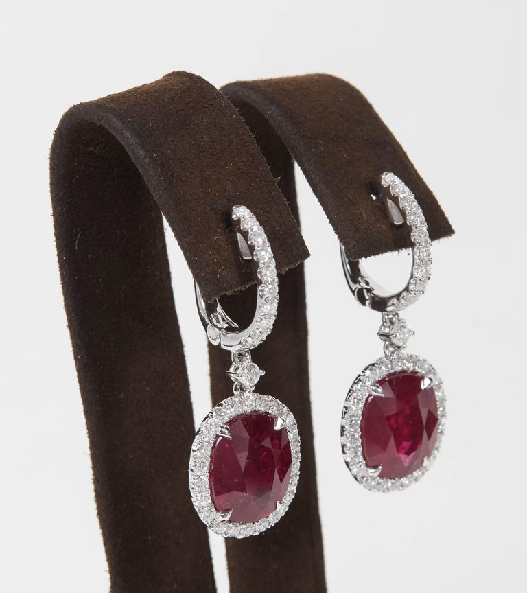 A beautiful Ruby and Diamond earring set in a wearable design.   13.70 carats of Fine Red Ruby (certified by GIA) set with 1.85 carats of round brilliant cut white diamonds.   18k white gold.  Approximately 2 inches in length from the highest to