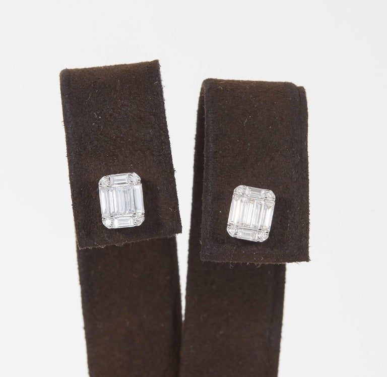 A beautiful pair of diamond stud earrings.   Made up of baguette and round cut diamonds, this earring has tons of sparkle and gives the look of one emerald cut diamond.   1.01 carats of F VS diamonds set in 18k white gold.  Approximately 7.9 mm x