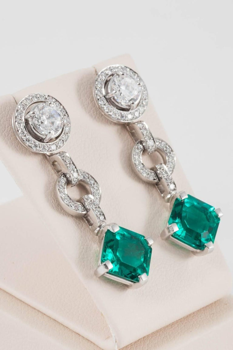 These beautiful earrings are able to be worn in three different ways. The earrings can be worn as a whole: or as single pair of diamond studs or as single pair of diamond studs with the halo for amore dressy occasion. Thus, giving possibly the most