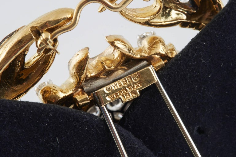 Stunning Zodiac Brooch, finely crafted in 18 k yellow gold, accented with round brilliant cut diamonds, weighing a total of approximately of 4.50 carat . Signed David Webb.