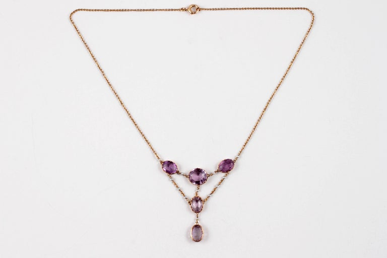 Edwardian Beauty!  Lovely shades of purple with accent seed pearls!  In 10 karat yellow gold, 16 inches in length, with a spring ring clasp.