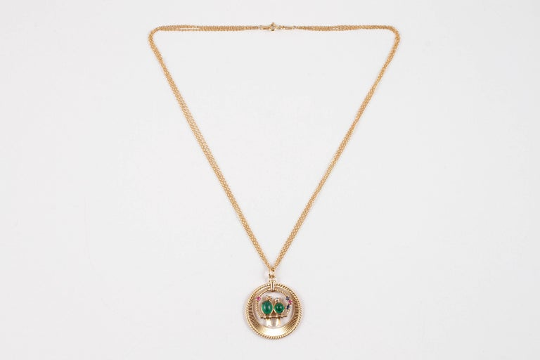Vintage and Fabulous!  This VCA pendant is composed of cabochon-cut emeralds as the bodies of birds, with accent rubies, sapphires and diamonds, all suspended from a 17 3/4 inch, 18 karat associated chain.