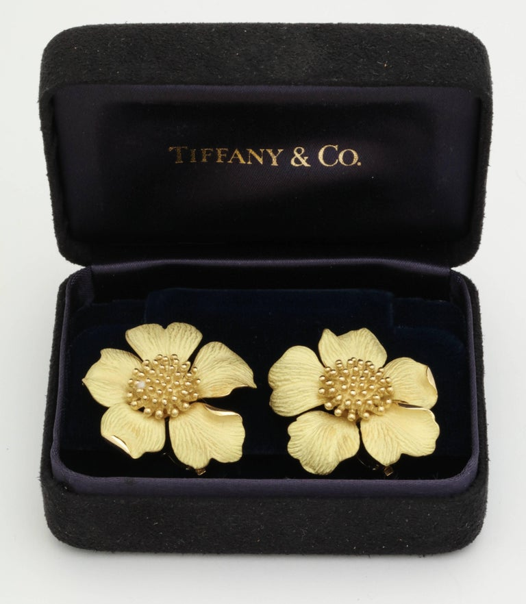 One Pair Of Ladies 18kt Silky Mate Finish Gold Earrings In The Form Of A Cherry Blossom Figural Flower. Very Realistic Formed Flowers With Pistil Centers In 18kt High Polish Gold. Further Designed With 18kt Yellow Gold High Quality Fancy Clip On