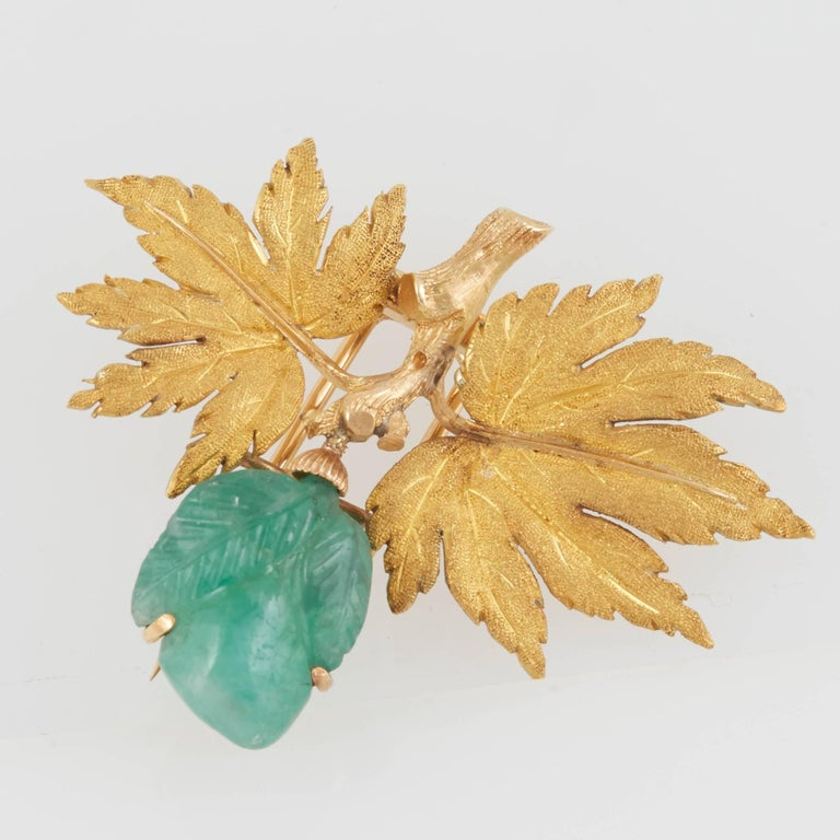 Unique brooch, finely crafted in 18k yellow gold with carved green emerald signed Buccellati
