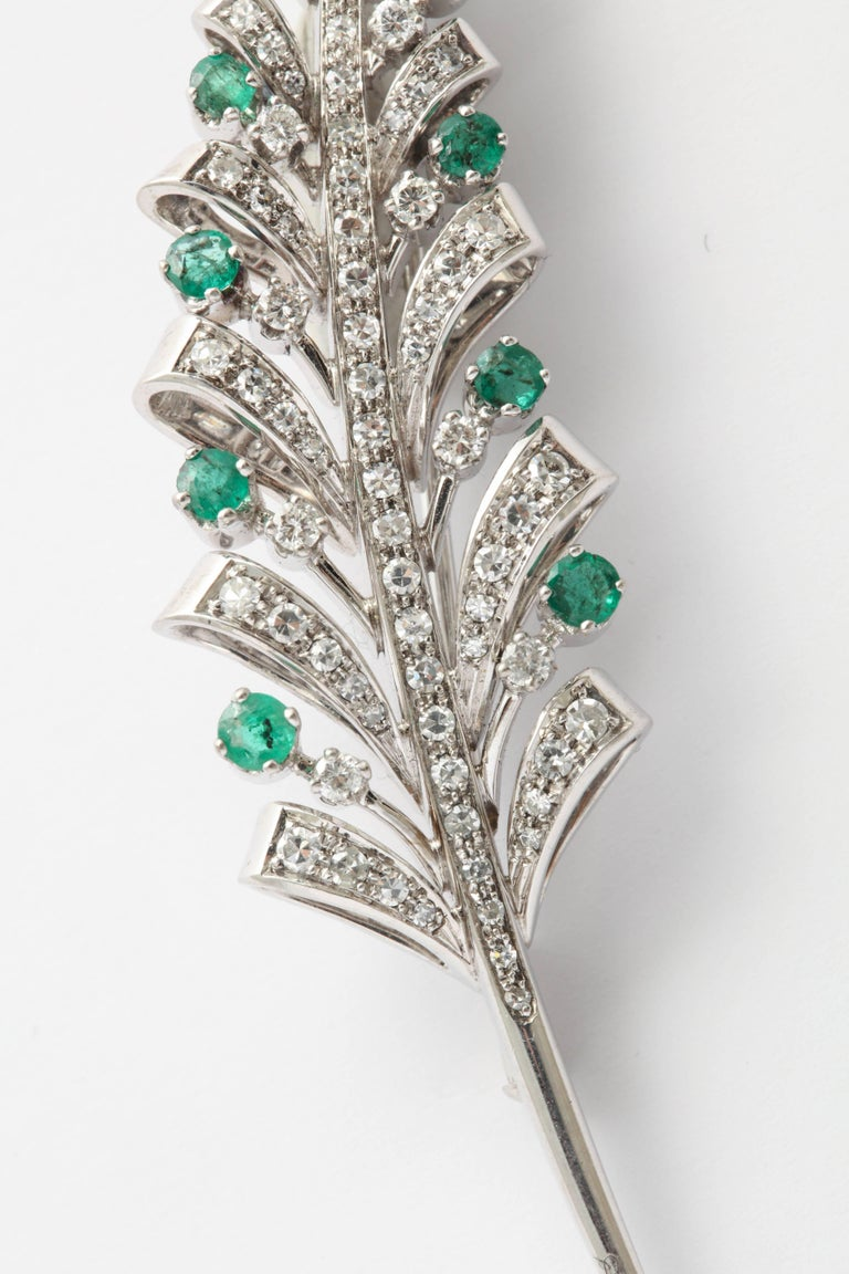 Single & Full cut Diamond and Emerald Pin set in 18kt White Gold.  8 Full cut Diamonds and 80 single cut Diamonds with 11 faceted Emeralds used as accent stones.  A lovely and graceful spray