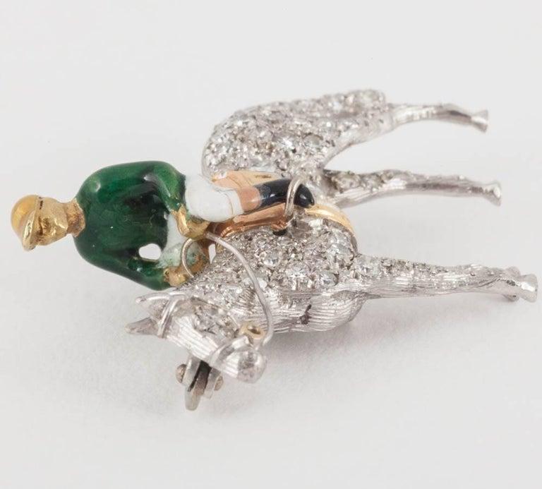 Racehorse and jockey brooch set diamonds and enamel silks,Alabaster and Wilson  2