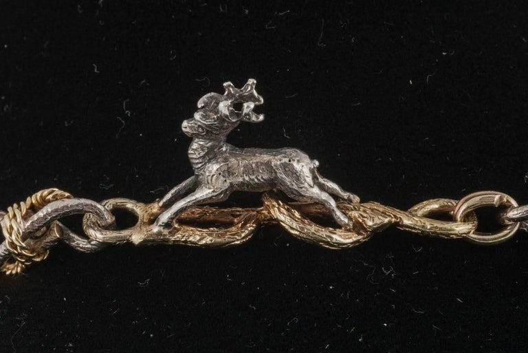 Hunting necklace of Stags, Hounds and Foxes,in silver and gold,19th century. 8