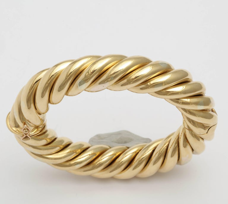 Heavy 18kt Yellow Gold Hinged Bangle made by Birks of Canada.  Quite a look!  Marked Birks's - Italy - 18 kt.   Very wearable for that ultra chic look.  Perfect for day or night.  Righto!