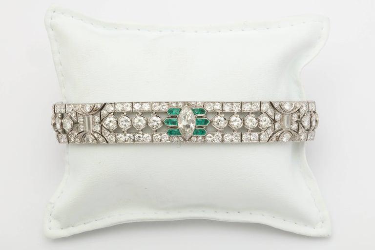 Pear Cut Important Art Deco Flexible Diamond with Emerald Accent Dressy Platinum Bracelet For Sale