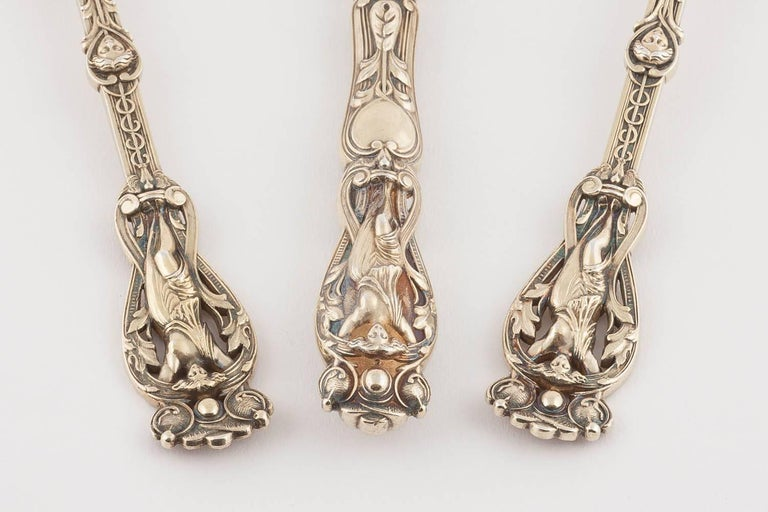 A rare example of this pattern made by Hunt & Roskell, comprising a silver gilt knife, fork and spoon the ornate handles decorated with full length maidens, foliate scrolls and pairs of putti, the blade of the knife partly engraved with scrolls.