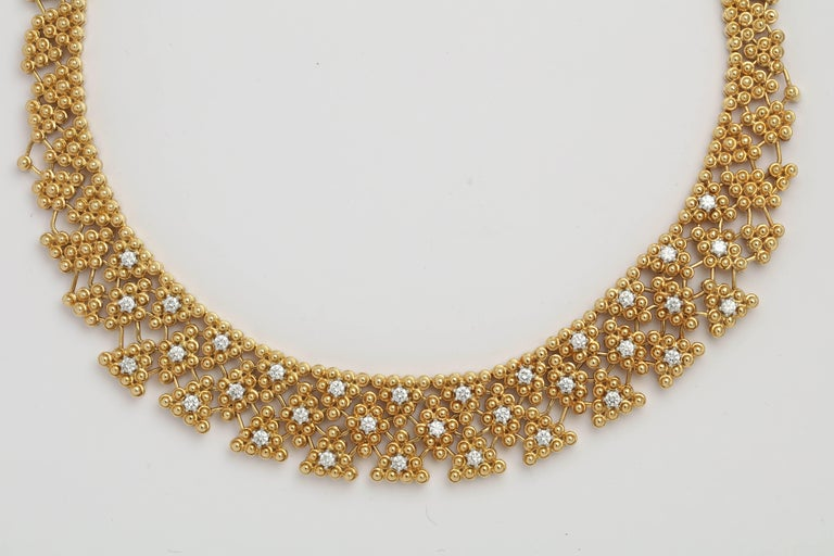 Magnificent 18kt Yellow Gold Necklace woven into a Collar.  Very regal without being overstated. Lays beautifully.  Center section is set with 33 full cut clean white Diamonds - set in Platinum.