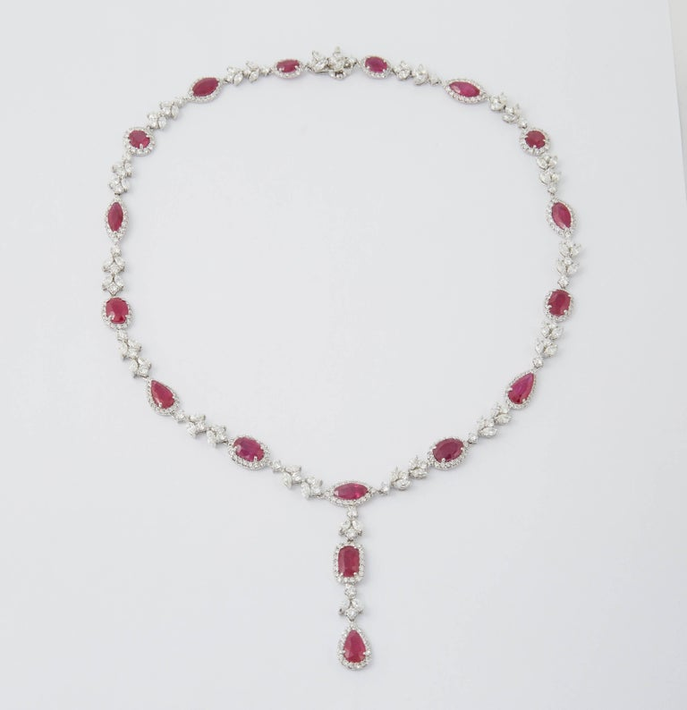 A beautiful one of a kind piece.  25.27  carats of vivid ruby in multiple shapes. Round, pear, cushion, oval and marquise.   14.75 carats of white diamonds, marquise and round brilliant shapes.  Approximately 17.5 inches in length with a 2 inch