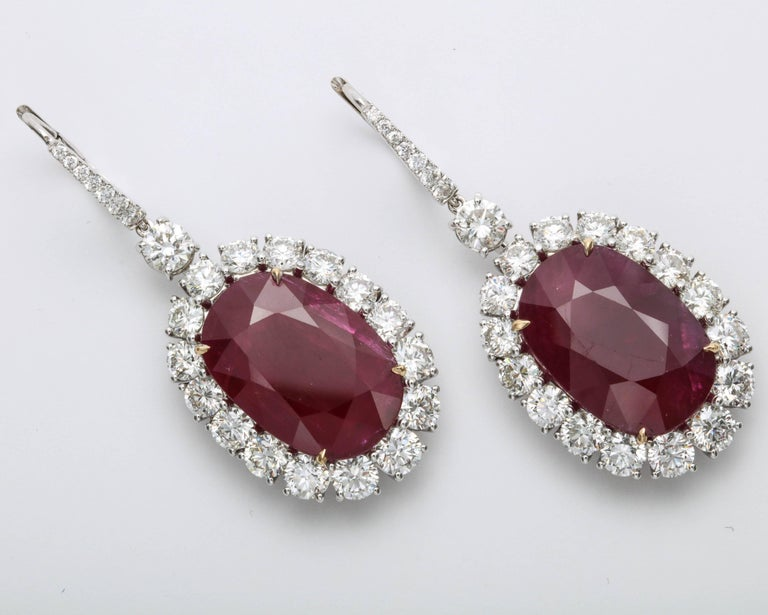 Spectacular Ruby and Diamond earrings!!  33.61 carats of impressive Ruby drops set with 10.06 carats of white round brilliant cut diamonds. Set in 18k white gold  Natural rubies of this size and color are a rare find!   The rubies are only heat
