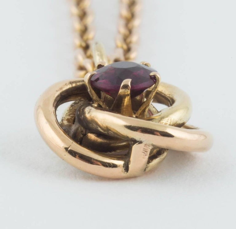 From the era of tsar Nicholas II, a rare Russian rose gold pendant centering a circular-cut almandine garnet, with gold suspension ring. Chain not included.  St. Petersburg, 1908-1917  ½ in. (1.3 cm.) diam; ¼ in. (.6 cm.) high.   $950