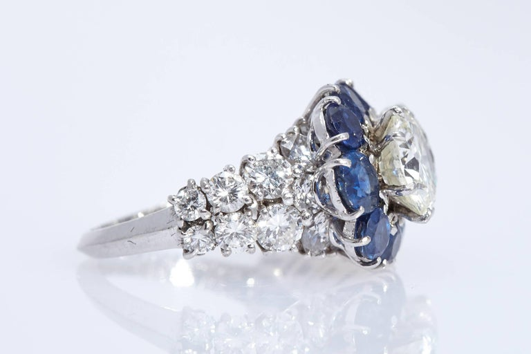 An elegant Van Cleef & Arpels ring in 18kt white gold, showcasing 3 round cut diamonds G/H Color, VS Clarity (0.5, 1.5, 2 cts) and sapphires. Made in France, circa 1955.