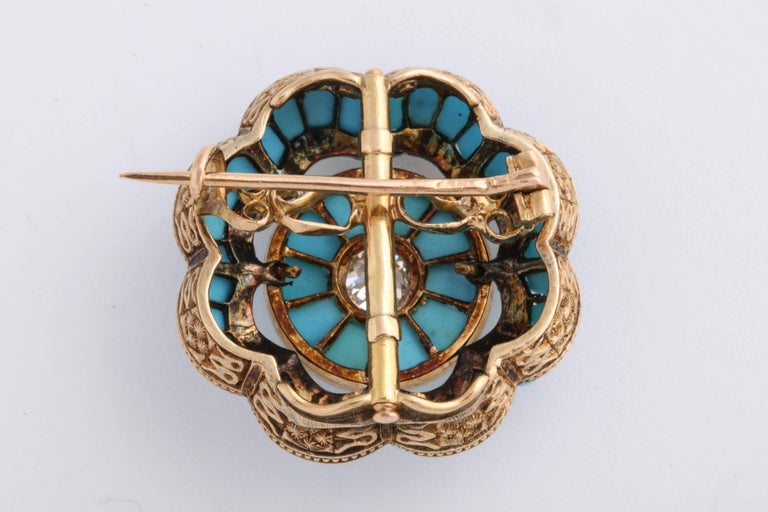 Turquoise and Diamond Brooch set in 18K yellow gold. Center old mine cut diamond is just under .50cts. Beautiful engraving in the scalloped design of the gold.