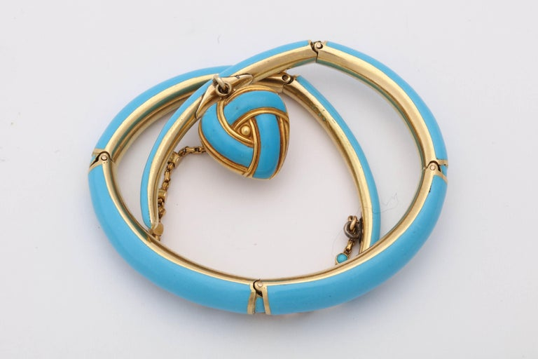 One 18kt Yellow Gold Wrap Around Bracelet Designed With Turquoise Color Blue Enamel Thruout The Bracelet. A Beautiful Handmade Heart Locket Is Dangling From The Front Of Bracelet With A Natural Pearl In The Center Of It. The Delicate Safety Chain Is